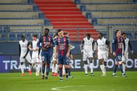 La déception de Jessy Deminguet et des Caennais après l'ouverture du score de Laura pour le Paris FC