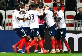 La joie des joueurs du Stade Malherbe Caen après le seul but de la rencontre, inscrit par Alexander Djiku